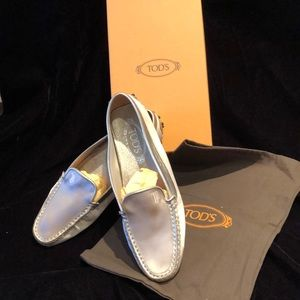 TODS gold satin driving shoe